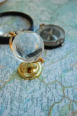 Map, globe and magnifying glass — Stock Photo