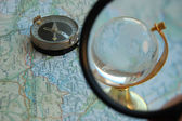 Magnifying glass directed on a globe — Stockfoto