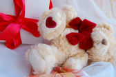 Gift box with red ribbon and teddy bear — Stock Photo
