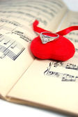 Music sheet with fabric heart and ring — Stock Photo