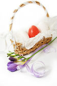 Basket with white and red eggs isolated on white — Stock Photo