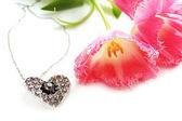 Pink tulips and jewelery — Stock Photo
