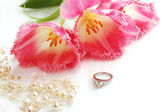 Pink tulips and wedding ring — Stock Photo