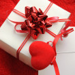 Gift box and fabric heart — Stock Photo #1860687