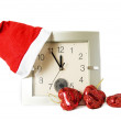Santa cap on clock - Stock Photo