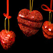 Christmas red hearts hanging - Stock Photo
