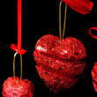Christmas red hearts hanging — Stock Photo