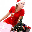 Royalty-Free Stock Photo: Santa helper and gifts