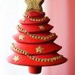 Christmas tree over white and pink back — Stock Photo