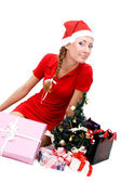Santa helper and gifts — Stock Photo