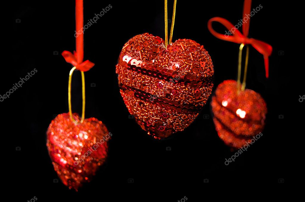 Christmas red hearts hanging over black  Stock Photo #1860974