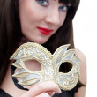 Royalty-Free Stock Photo: Mysterious woman holding venetian mask