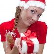Stock Photo: Joyful Santa helper with present box