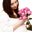 Beautiful pregnant woman with flowers — Stock Photo
