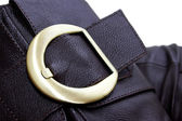 Golden buckle of leather brown boot — Stock Photo