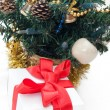 Gift with red ribbon — Stock Photo