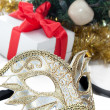 Mask over Christmas decoration — Stock Photo