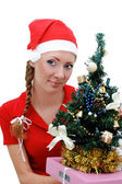 Santa helper with Christmas tree — Stock Photo