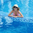 Smiling woman in swimming pool — Stock Photo #1918064