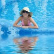 Smiling woman in swimming pool — Stock Photo #1919181