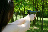 Woman's hand aiming pneumatic gun — Photo
