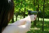 Woman's hand aiming pneumatic gun — Stockfoto