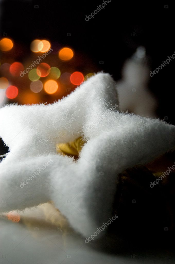 Christmas star toy over light background — Stock Photo #1918385