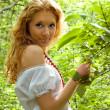 Redhead girl among forest — Stock Photo