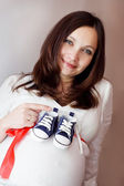 Pregnant and blue shoes — Stock Photo