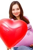 Pregnant woman and balloon — Stock Photo