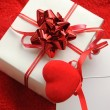 Gift box and fabric heart - Stock Photo