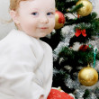 Adorable baby boy and Christmas tree — Stock Photo #2068620