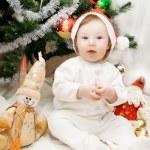 Sitting under Christmas tree — Stock Photo