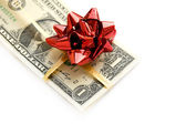 Jeden dolar banknotów związany przez czerwoną wstążką — Zdjęcie stockowe