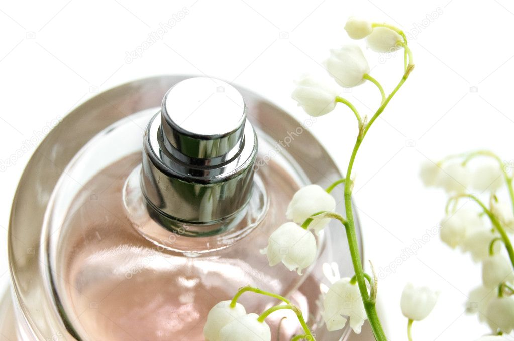 Bottle of perfume and lilies-of-the-valley — Stock Photo #2081106