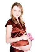 Pretty pregnant woman with pink ribbon — Stock Photo