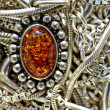 Silver little chains and amber pendant — Foto de Stock