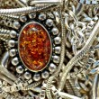 Silver little chains and amber pendant — Stock Photo