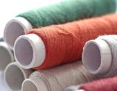 Bobbins of colorful thread — Stock Photo
