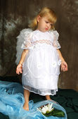 Sad girl in a white dress with wings — Stock Photo