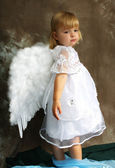 Girl in a white dress with wings — Stock Photo