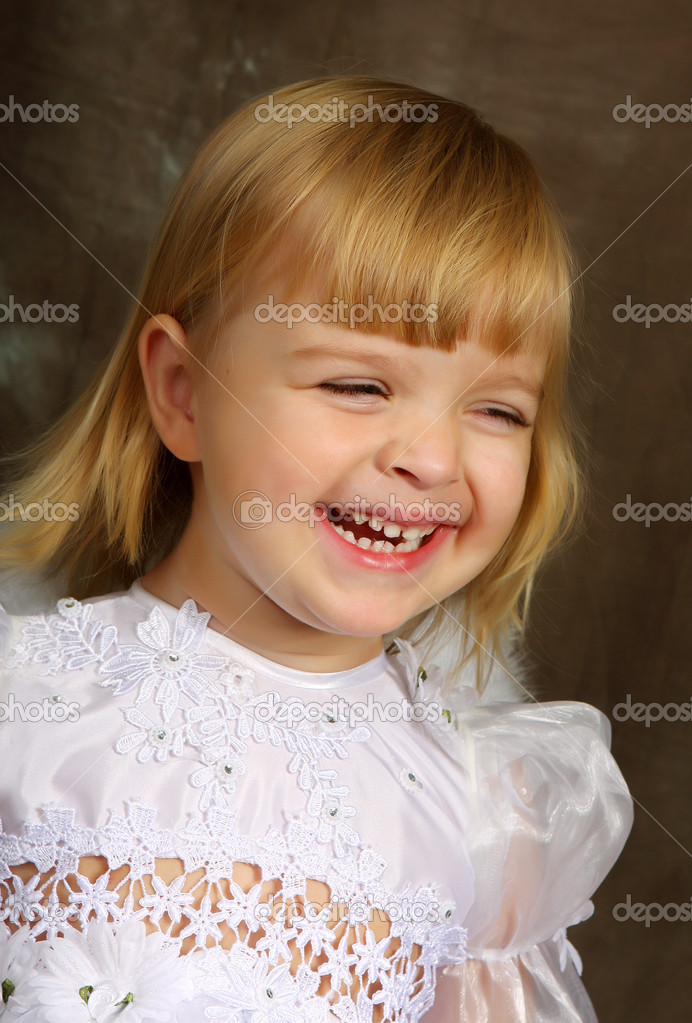 Laughing girl in a white dress — Stock Photo #1850703