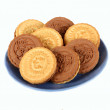 Shortbread two colors on a blue saucer — Stock Photo