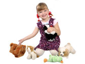 Girl with soft toys — Stock Photo