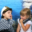 Girl kissed a boy seaman — Stock Photo