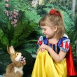 Girl dressed as Snow White and the hare — Stock Photo #2017031