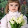 Girl in a beautiful blouse with tulips — Stock Photo