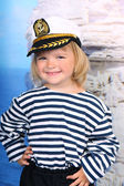 Girl in the Marine dress and cap — Stock Photo