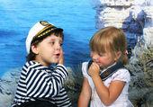 Girl kissed a boy seaman — Stock Photo