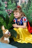 Girl dressed as Snow White and the hare — Stock Photo